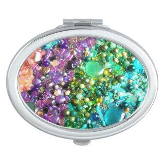 Colección de gotas brillantes coloridas espejos de viaje