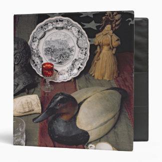 Colección de objetos, incluyendo una taza