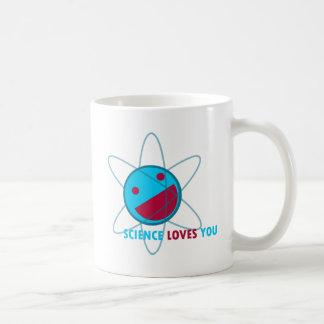 Colección feliz del átomo taza