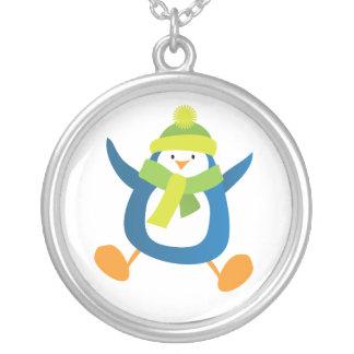 Colgante de salto del pingüino del invierno