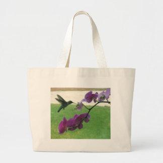 Colibrí con la orquídea bolsas