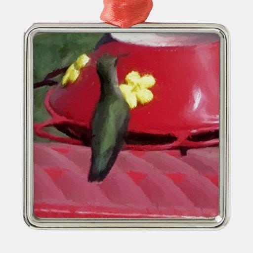 Colibrí pintado en el alimentador ornamento de reyes magos
