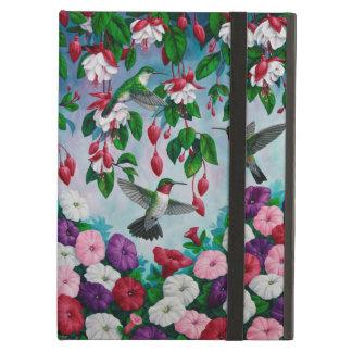 Colibríes en jardín de flores fucsia