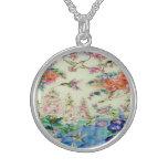 Colibríes y collar de las flores - hermoso