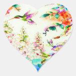 Colibríes y paisaje rosado de las flores colcomanias de corazon