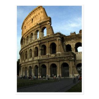 Coliseo en la puesta del sol postales