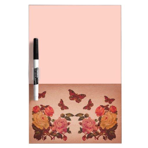 Collage bonito de los rosas y de las mariposas del tablero blanco