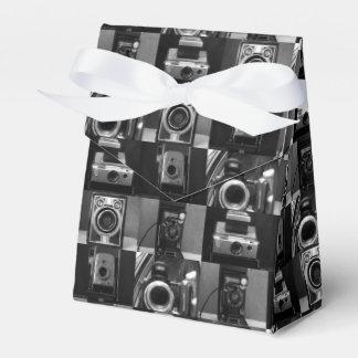 Collage de la cámara en caja del favor de la paquete de regalo para fiestas