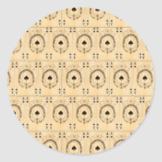 Collage de los naipes de las espadas del as del pegatina redonda