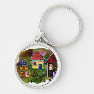 Collage de tres casas con las flores llavero redondo plateado