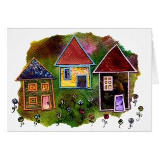 Collage de tres casas con las flores tarjeton