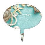 collage del seashell en fondo de la turquesa decoración para tarta