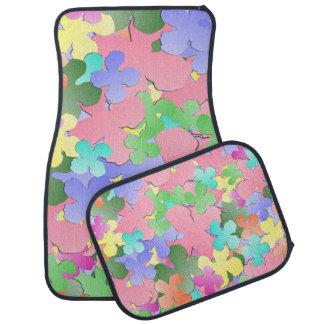 Collage en colores pastel de la flor alfombrilla de auto