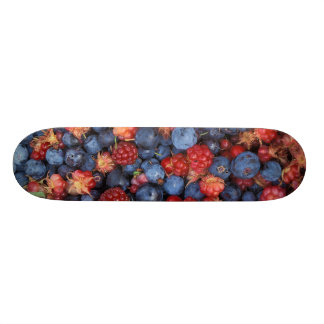 Collage of Wild Berries Blueberries Raspberries Skateboard