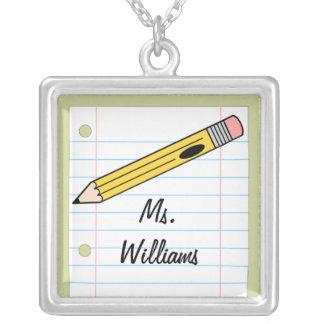 Collar del profesor - papel amarillo del lápiz y d