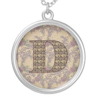 Collar floral elegante inicial del monograma D