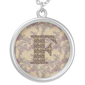 Collar floral elegante inicial del monograma F