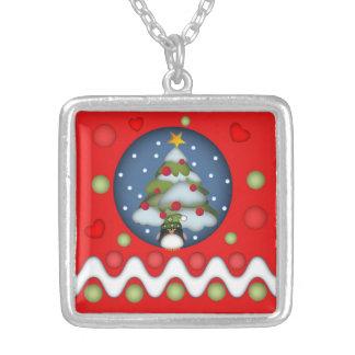 Collar lindo de Navidad con el árbol, las chucherí