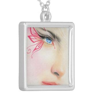 Collar rosado del ojo azul de la mariposa