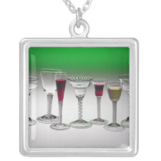Collection of wine glasses with twist stems silver plated necklace