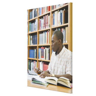 College student working in library stretched canvas prints