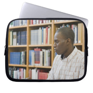 College student working in library computer sleeve