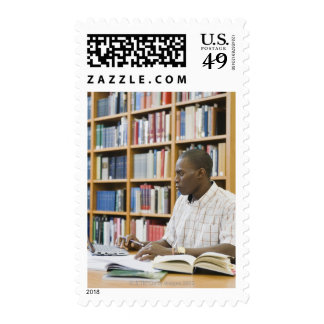 College student working in library stamps
