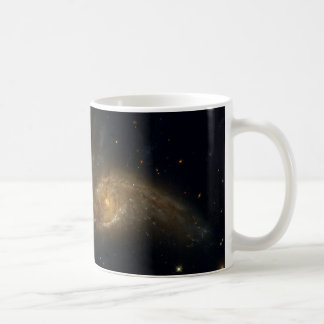 Colliding Galaxies NGC 2207 IC 2163 by the Hubble Coffee Mugs