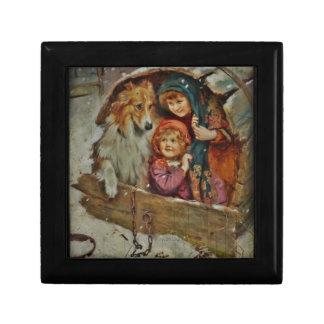 Collie y niños en la caseta de perro cajas de regalo