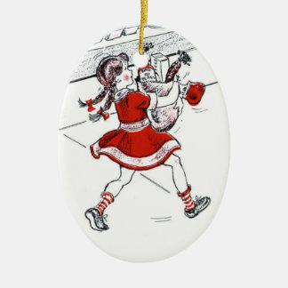 Colmado y niña pasados de moda adorno navideño ovalado de cerámica
