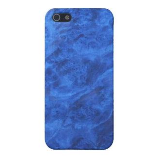 Colmillos ocultados en caja azul de la mota del iPhone 5 carcasas