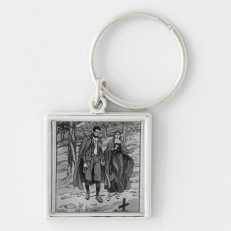 Colomba & her brother beside their father's Silver-Colored square keychain