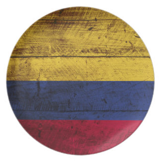 Colombia Flag on Old Wood Grain Plate