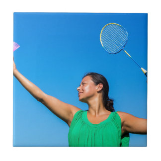 Colombian woman serve with badminton racket ceramic tile