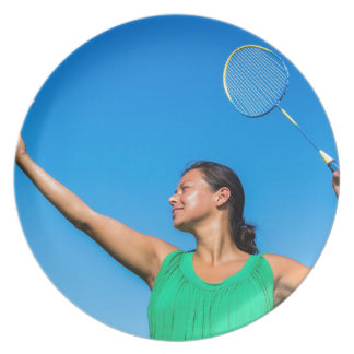 Colombian woman serve with badminton racket melamine plate