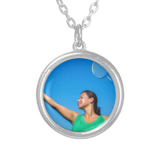 Colombian woman serve with badminton racket silver plated necklace