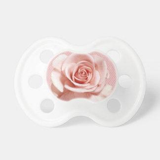 Color de rosa rosado bonito chupete de bebe