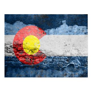 colorado flag brick wall postcard