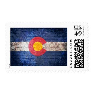 Colorado flag grunge brick wall postage stamps