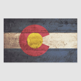 Colorado State Flag on Old Wood Grain Rectangular Sticker