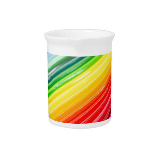 Colored crayons lying side by side drink pitcher