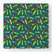 Colored Pencils on Green Grid Square Wall Clock