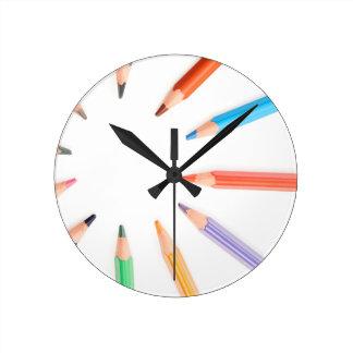 Colored pencils representing the sun rays round clock