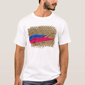 Colored towels on sandy beach T-Shirt