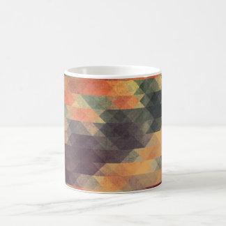 Colores llevados rayas intrépidas geométricas taza
