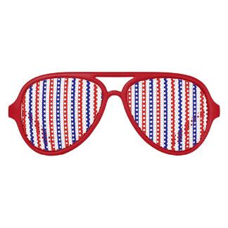 Colores rojos, blancos, y azules del equipo de gafas de fiesta
