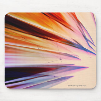 Colorful abstract objects against white mouse pad
