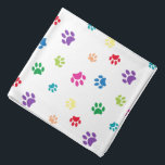 "Colorful Animal Paw Prints Bandana<br><div class=""desc"">Show how much you love animals with this cute colorful paw patterned bandana. Also looks awesome with a black background. Bet your pet will look adorable wearing it!</div>"