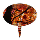 Colorful Autumn Leaves Reflected in Water Oval Cake Topper