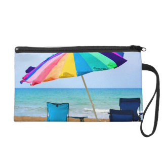 Colorful beach umbrella and chairs in Florida Wristlet Clutch